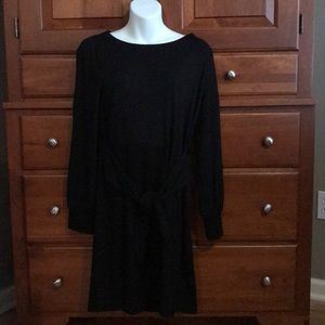 Black dress with sachet belt and cuffed sleeve.NWT